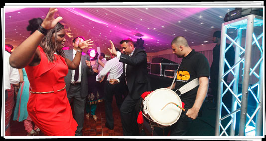 Dhol players doing a set at a party