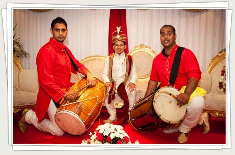 Dhol players escorting groom