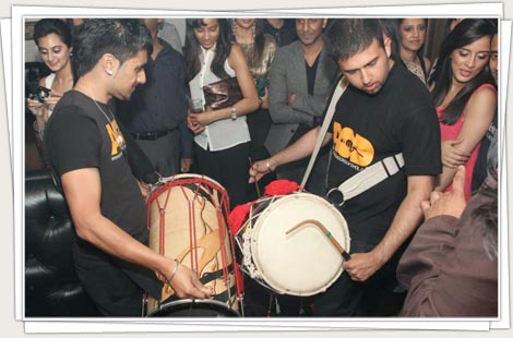 Dhol players performing at a party